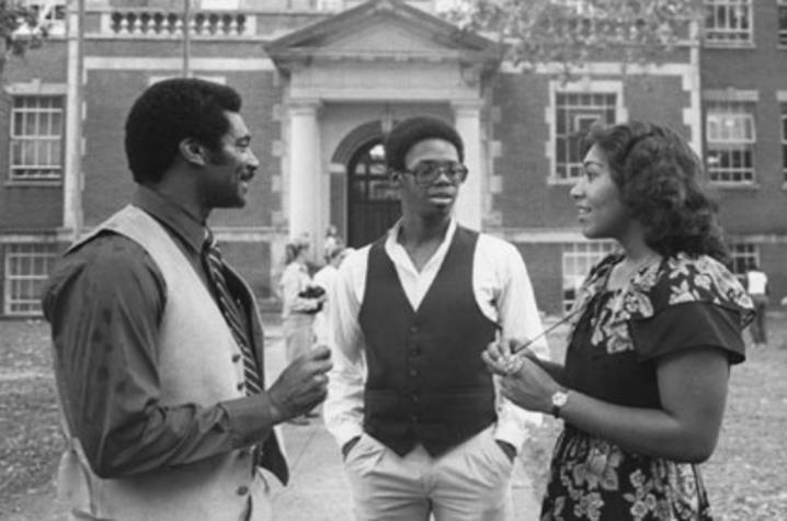 1978 black and white photo of college recruiter Alvin C. Hanley with 2 others on campus