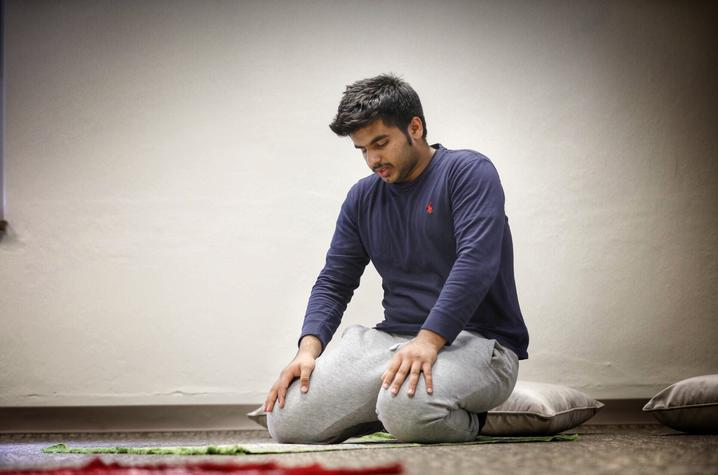 UK freshman Yousuf Al Mamari prays in the new interfaith prayer and meditation room (Photo by Mark Cornelison, UK Photographer)