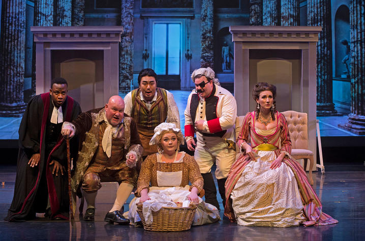 "photo of cast of UK Opera Theatre's ""The Barber of Seville"""