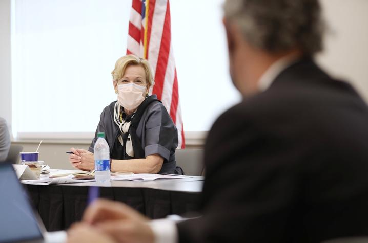photo of Deborah Birx wearing a maxk during a roundtable discussion
