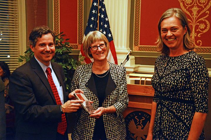 photo of Doug Boyd and Joanna Hay (right) present bourbon documetary to AFC Director Elizabeth Peterson