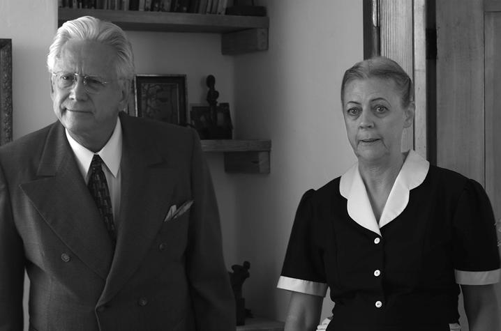 "black and white photo of still from ""Cemetery Tales"" of actor in suit and actress in maid costume"