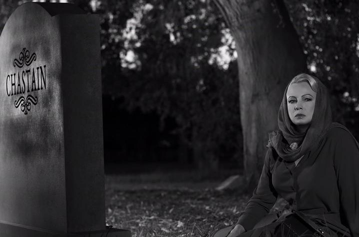 "black and white photo of still from ""Cemetery Tales"" of actress at tombstone"