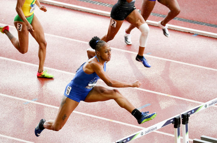 photo of Jasmine Camacho-Quinn competing in hurdles