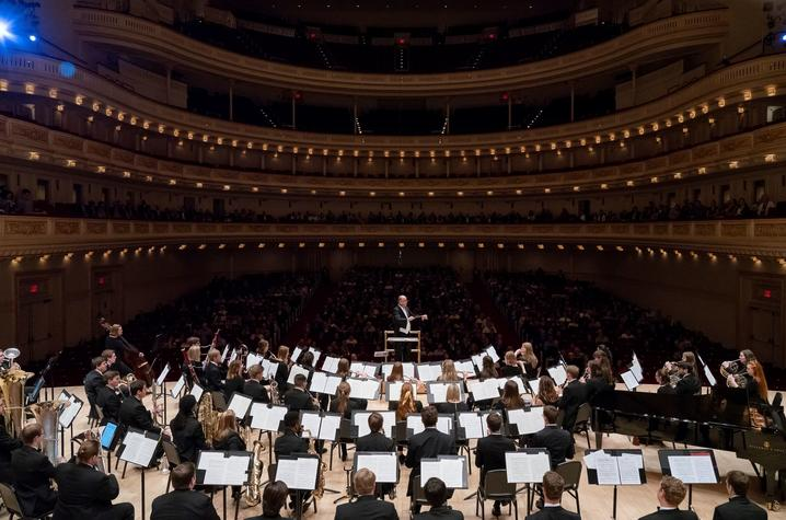 photo of Cody Birdwell conducting the UK Wind Symphony at Carnegie Hall in 2019