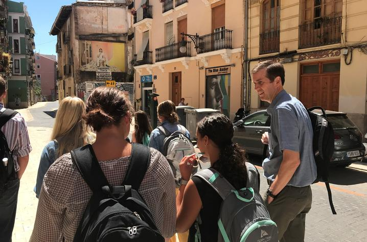 UK Deputy General Counsel Cliff Iler walks with Education Abroad students in city in Spain