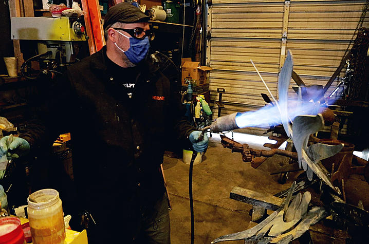 photo of Jeremy Colbert using a torch to make a sculpture