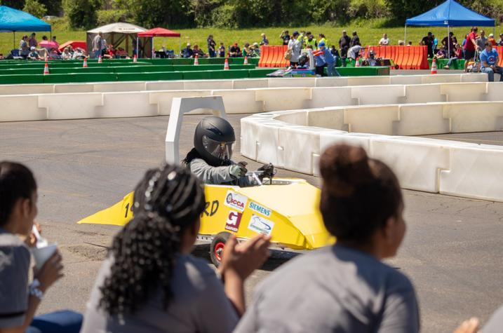 photo of student racing an electric vehicle