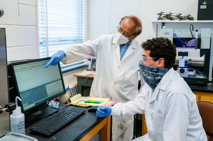 "UK engineering professor Dibakar Bhattacharyya, or ""DB,"" directing research in his lab. With co-researchers, DB is creating a membrane-based medical face mask for COVID-19. Photo by Ben Corwin, Research Communications"