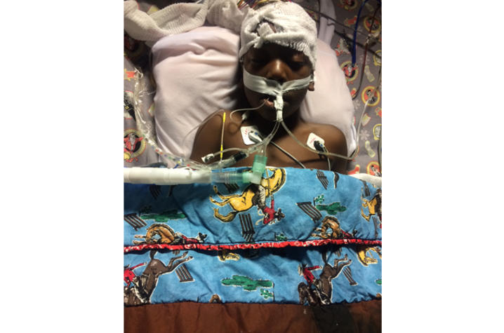 Daniel Johnson in a hospital bed after surgery