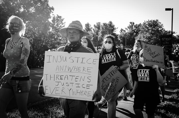 black and white Alethea Devary photo of protest