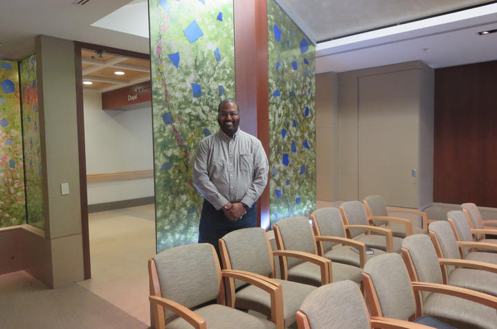 Man standing in Hospital Chapel