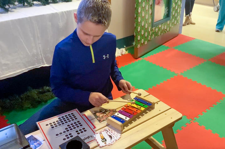 photo of dalton green playing toy xylophone