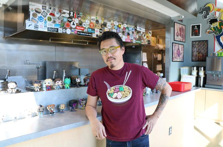 photo of Dan Wu in front of his kitchen at Atomic Ramen in The Barn at The Summit