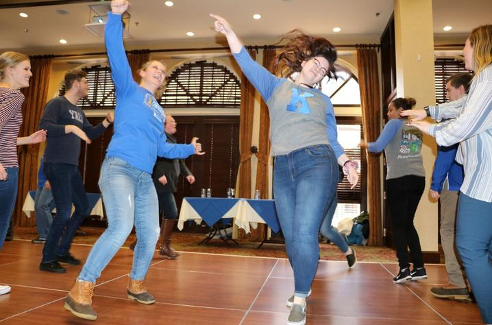 people dancing at a previous DanceBlue Dance Party held at the Boone Center.