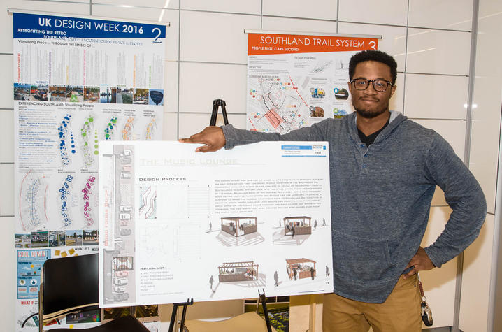 "photo of Rakeem Bradshaw with his Music Lounge proposal for ""Retrofitting the RETRO"""