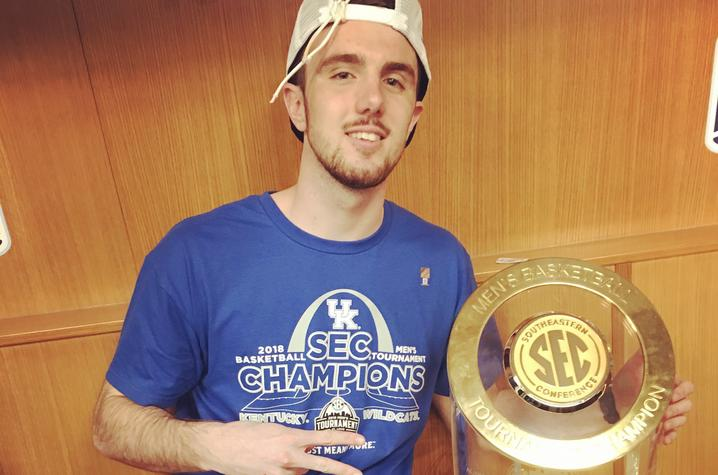 photo of Dillon Pulliam and SEC trophy