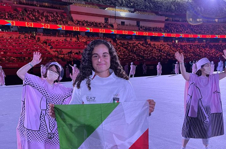 photo of Alexia Lacatena poses with Italy's colors during the Olympics opening ceremony