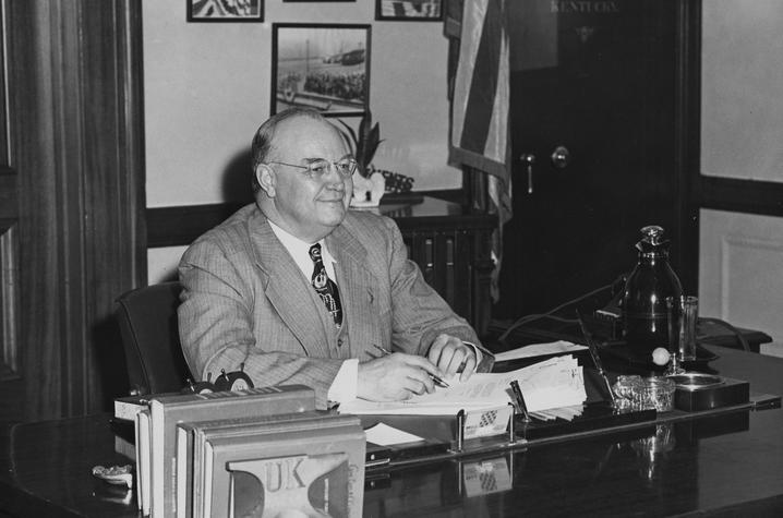 photo of Governor Earle C. Clements at desk