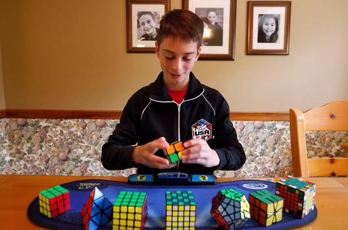 photo of Lucas Etter with cubes
