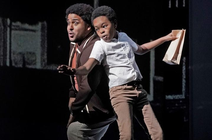 """photo of Christopher Kenny with child actor performing it the Met's """"Fire Shut Up in My Bones"""""""