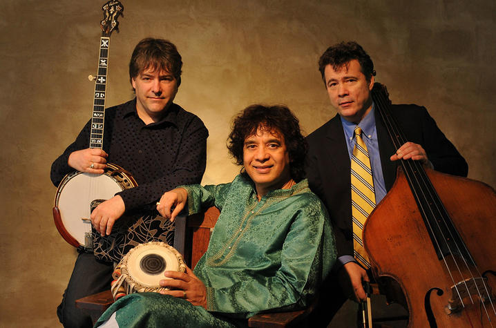 photo of Bela Fleck, Edgar Meyer (seated) and Zakir Hussain with instruments