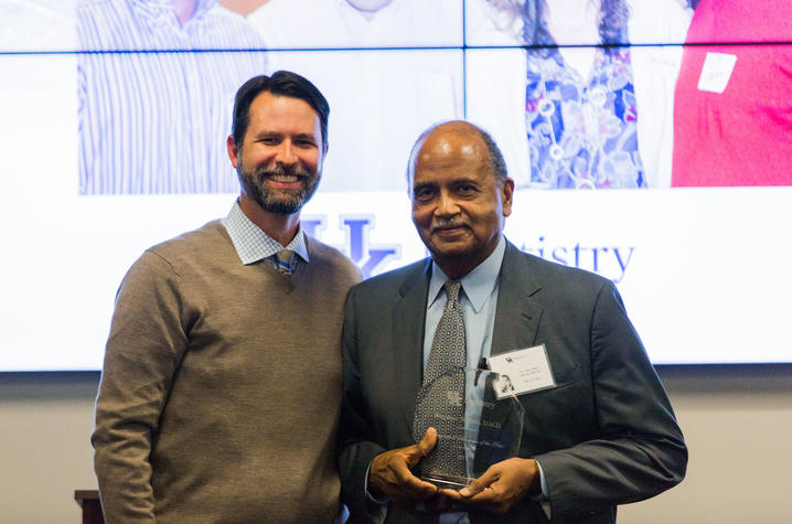 Dr. Nero accepts his Alumni of the Year award from UKCD, 2017