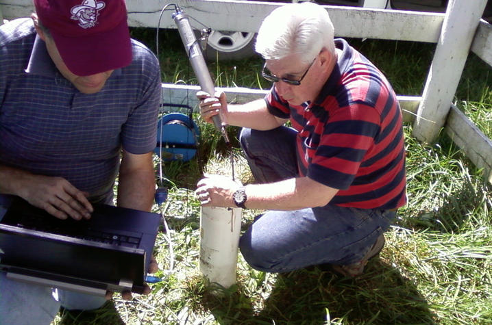 KGS Water Resources Section Head Chuck Taylor and Steve Webb install water monitoring equipment for the Kentucky Groundwater Observation Network.