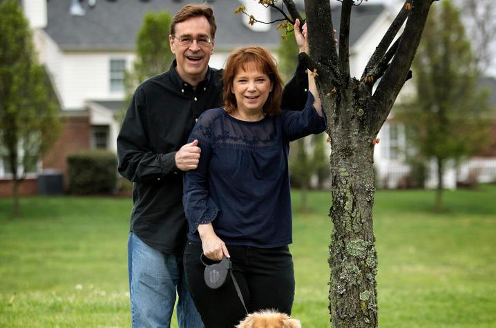 "Photo of Gregg and Kim Whiteker at their ""Praying Tree."" Mark Cornelison | UK Photo"