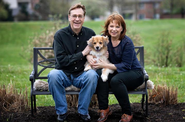 Photo of Gregg and Kim Whiteker with their dog Gracie. Mark Cornelison | UK Photo