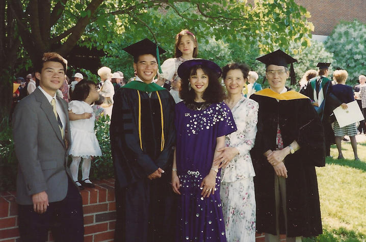 """UK College of Medicine graduation in 1993. L to R: John Huang, brother, Katie Huang, John's daughter, Michael Huang, Hannah Johnson, niece, Mary Ensom, sister, Jane Huang, mother, and Yang """"Pete"""" Huang/"""