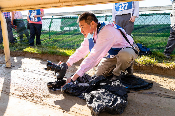 Michael Huang under the rails at the 2021 Kentucky Derby.