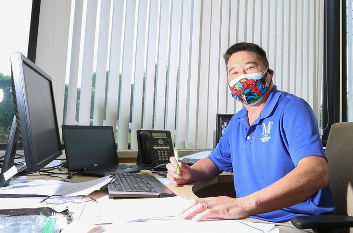 Michael Huang at his desk at Marathon.