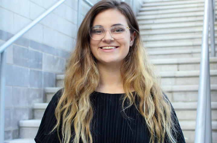 photo of Hannah Scinta in front of stairs at Student Center