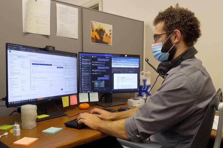 UK Health Corps wellness connector Evan Ayoub at desk