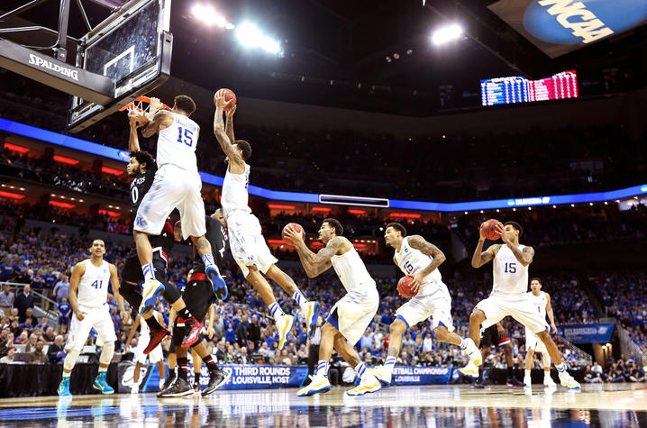 Photo by Michael Huang: Time lapse of Willy Cauley Stein dunking on Cincinnati player during 39-1 season.