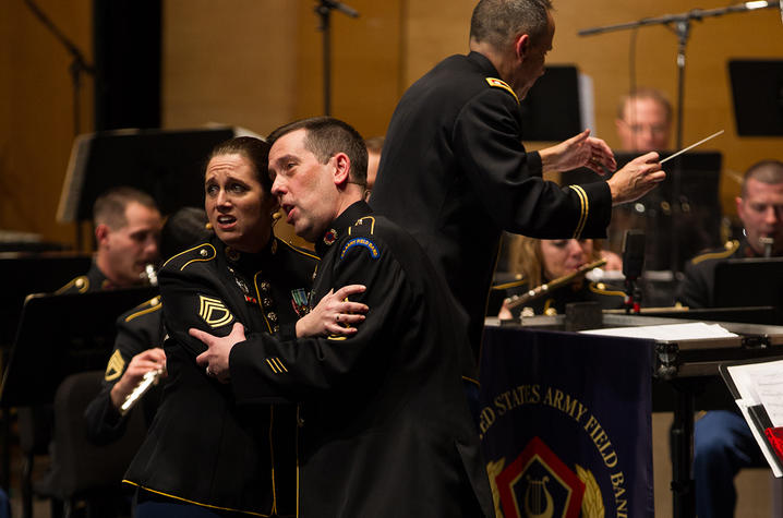 photo of Charis Strange and Mark Huseth performing duet in front of US Army Field Band - Concert Band