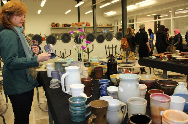 photo of lady looking at ceramic vase at ceramics sale at Open Studio 2017