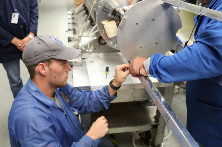 Photo of Devin Sparks integrating UK payload inside the rocket at NASA Wallops.