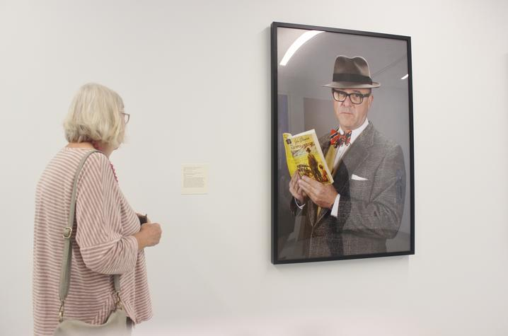 "photo of visitor looking at ""What I Read (The Grapes of Wrath)"" by Louis Zoellar Bickett"