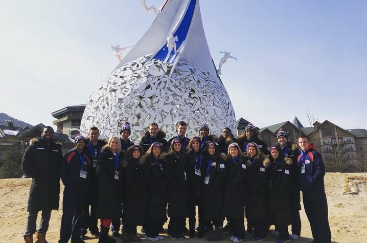 This is a photo of the UK Cheerleaders, representing USA Cheer & Team USA, at the 2018 Winter Olympics.