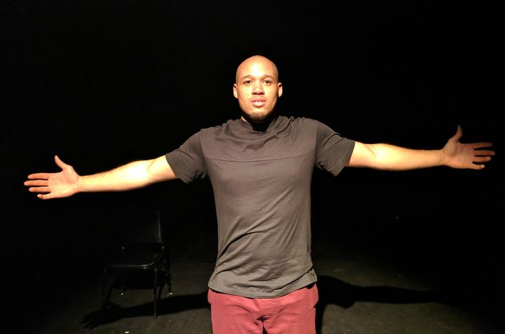 """photo of Jeremy Gillet with arm stretched out performing """"Black & 25 in America"""""""