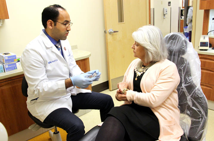 Dr. Musbah explains function of oral appliance to patient Linda Pike