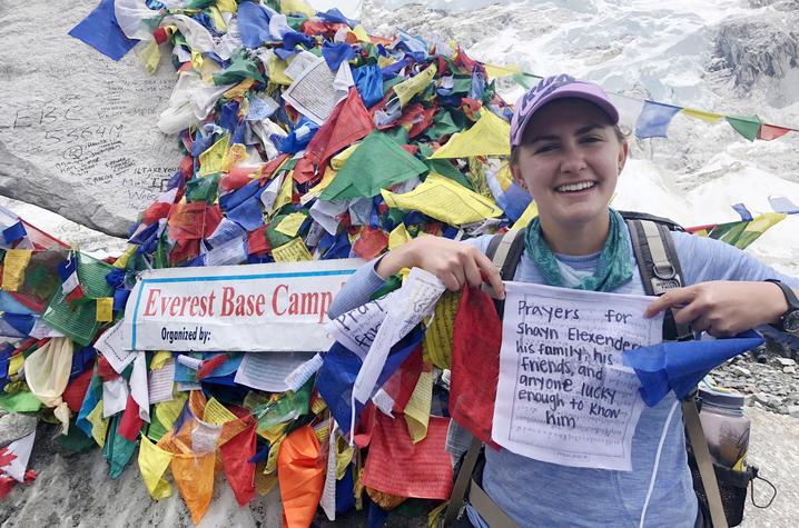 Maya Husayni with prayer flags at Mt. Everest Base Camp