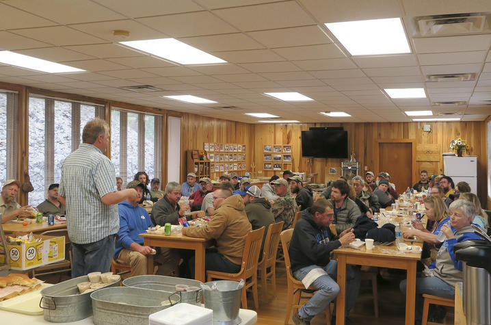 photo of Chris Barton talking with volunteers
