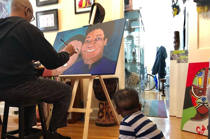 Photo of Frank X Walker painting in his Lexington home.