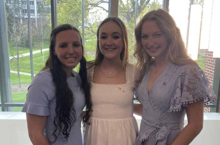 Ainsley Flask, director of programming (left), Savannah Miller, president (middle), and Kelli Burnett, vice president (right) pictured at initiation on April 18, 2021.