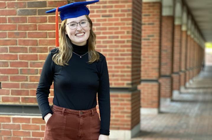 photo of Kyra Seevers wearing mortar board