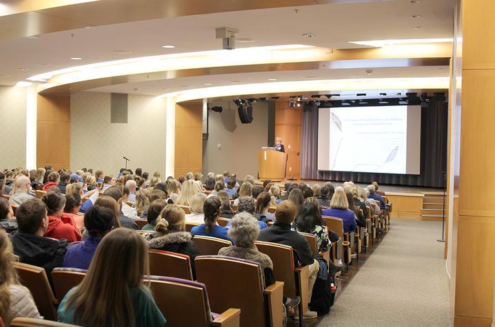 Dr. Cynda Ruston speaks with nursing students in the Karpf Auditorium.
