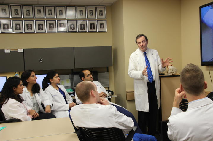 Dr. Okeson working with a group of clinic residents   Photo courtesy UK Dentistry